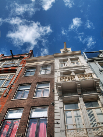 Typical Dutch houses stock photo, Typical Dutch houses in Amsterdam under blue sky with clouds by Laurent Dambies