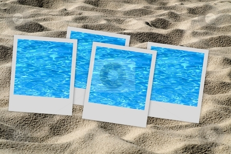 Set of pictures on sand stock photo, Set of four  polaroid pictures  placed on sand background by Laurent Dambies