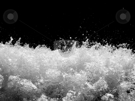 Stormy river stock photo, Powerful stormy river with water drops captured on black background by Laurent Dambies