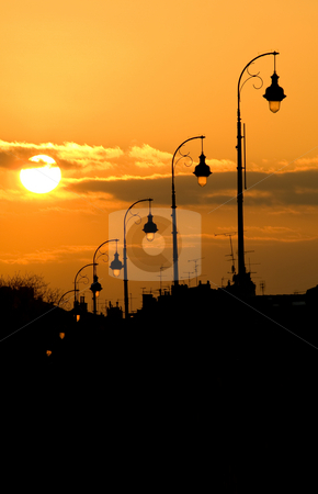Lamp post at sunset stock photo, Lamp post at sunset of the Pont Neuf bridge in Toulouse France by Laurent Dambies