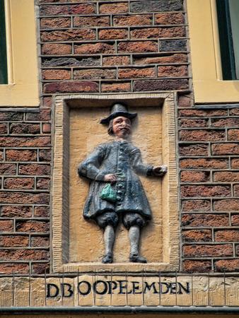 Amterdam wall statue stock photo, Details of a house facade  of Amsterdam on Zeedijk street by Laurent Dambies