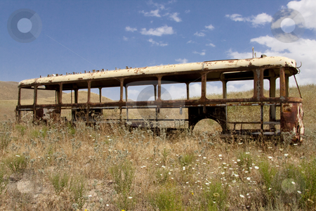 Old bus stock photo, Old broken bus on the meadow in Armenia. by Tomasz Parys