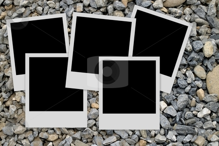 Photo frames on stones background stock photo, Pile of  empty photo frames  on stones background by Laurent Dambies