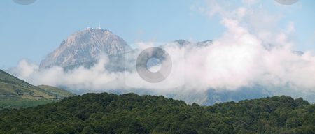 Mountain range panorama with clouds stock photo, Panoramic view of the pic du midi observatory in the pyrenees view from North East by Laurent Dambies