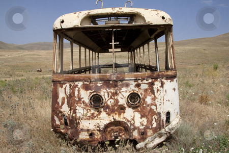 Broken bus stock photo, Broken bus on the meadow - Armenia. Summer day. by Tomasz Parys