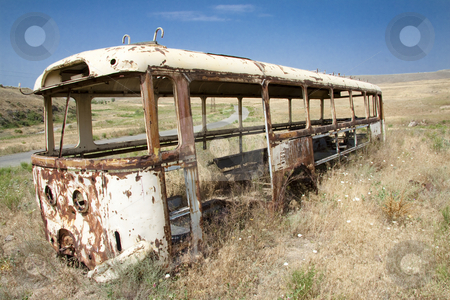 Old bus on the meadow stock photo, Old bus on the meadow in background small route. Armenia by Tomasz Parys