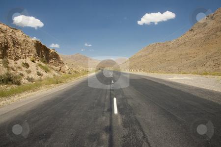 Route on the desert stock photo, Straight route on the desert. Mountain view - Armenia. by Tomasz Parys