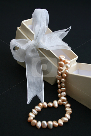 Box stock photo, Small cream colored box with ribbon and pearl necklace by Vanessa Van Rensburg