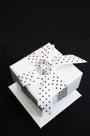 Box stock photo, Small white box with a black and white spotted ribbon by Vanessa Van Rensburg