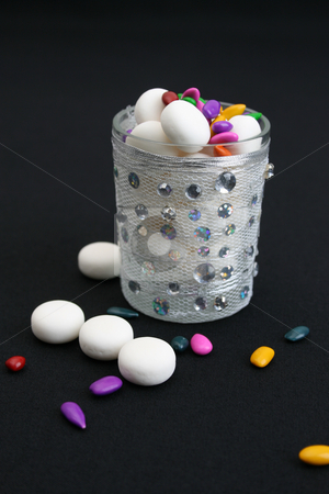 Decorated Glass stock photo, Decorated glass wih mints on a black background by Vanessa Van Rensburg