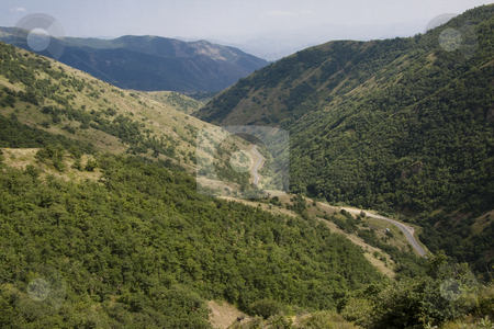 Route in valley stock photo, Small route in valley in Armenia. Big mountain, summer day. by Tomasz Parys