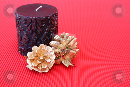 Candle and Pine Cones stock photo, Dark pattern candle with golden christmas pine cones by Vanessa Van Rensburg