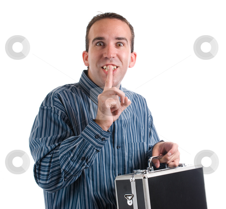 Man Sneaking Case stock photo, A man sneaking away a private case and telling the viewer to be quiet, isolated against a white background by Richard Nelson