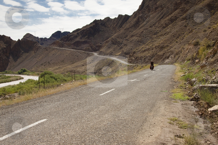 Cyclo - tourism in Iran stock photo, Man on the bicycles in Iran. Aras river and mountain. Border with Azerbijan by Tomasz Parys