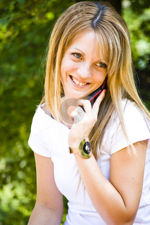 Beautiful young woman talking on phone stock photo, Beautiful young model talking on phone by Desislava Dimitrova
