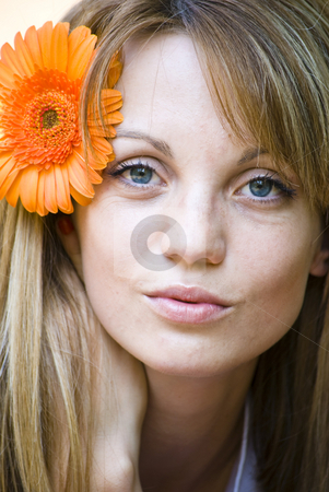 Portrait of beautiful young woman stock photo, Portrait of beautiful young blond woman with gerbera flower by Desislava Dimitrova