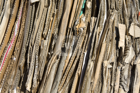 Cardboard stock photo, Corrugated cardboard packed for recycling by Darren Pattterson