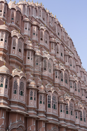 Hawa Mahal Palace of the Wind stock photo, Hawa Mahal is a palace in Jaipur, India. Build in 1799, it forms part of the City Palace and was the women\'s quarters (harem) designed to provide the residents with discreet views of the street below. by Sharron Schiefelbein