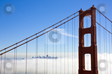Bridge to the city in the clouds stock photo, Photo of the golden gate bridge with San Francisco in the distance surrounded by clouds by Darren Pattterson