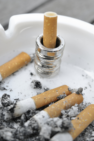 Cigaretts in a ashtray stock photo, Cigaretts in a ashtray by Carmen Steiner