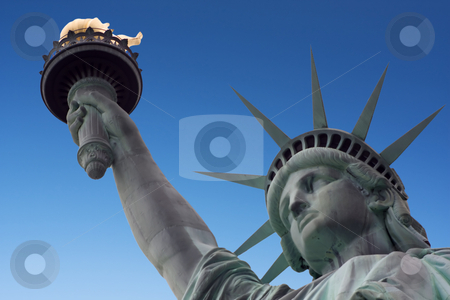 Statue of liberty and arm stock photo, Statue of liberty with a blue sky background by Darren Pattterson