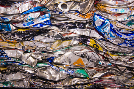 Squashed cans stock photo, A close up of metal drink cans squashed for recycling by Darren Pattterson