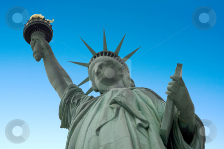 Statue of Liberty stock photo, Statue of liberty with a blue sky background by Darren Pattterson