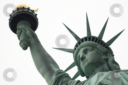 White background Liberty stock photo, Close up of the Statue of Liberty head, arm and flame on a white sky background by Darren Pattterson