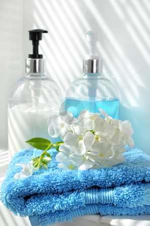 Wellness day stock photo, Blue towel, flower, cream and soap by Carmen Steiner