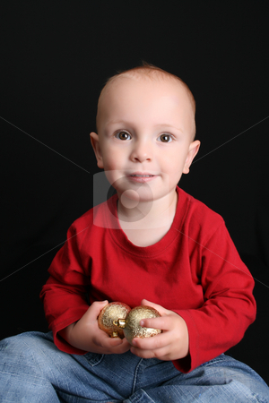 Toddler stock photo, Blonde toddler against a black background with a smile by Vanessa Van Rensburg