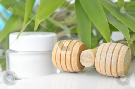 Massage and Care stock photo, Massage block and cream container in front of bamboo by Carmen Steiner