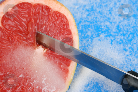 Pomelo stock photo, Half Sliced Pomelo on a bright background by Vanessa Van Rensburg