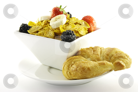 Cornflakes and Fruit with Croissant stock photo, Cornflakes with strawberries, blackberries and banana in a square white bowl with a croissant on a plate with a white background by Keith Wilson