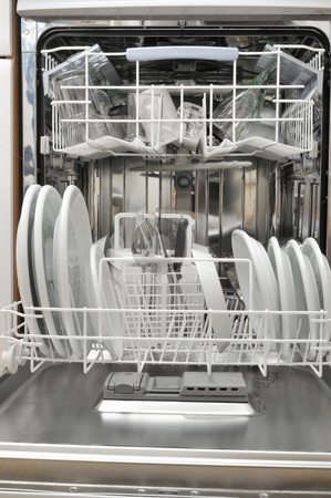 Dishwasher stock photo, View into a dishwasher by Carmen Steiner
