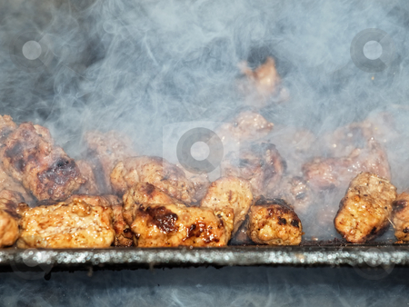 Smoky barbecue stock photo, Closeup of dumplings of minced meat on a smoky barbecue. by Sinisa Botas