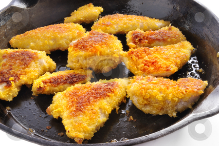 Chicken Nuggets stock photo, Chicken Nuggets in a pan by Carmen Steiner