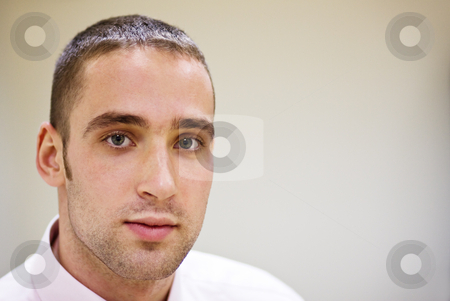 Young man stock photo, Portrait of a young adult man; selective focus by Mikhail Lavrenov