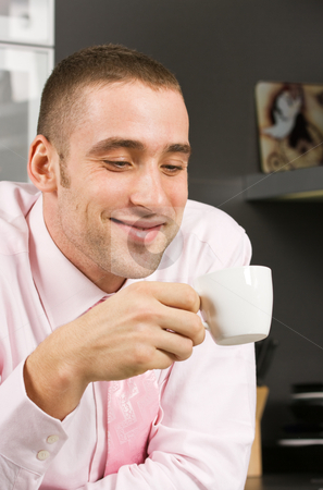 Cup of coffee stock photo, Smiling young man in formal dress sitting with a cup of coffee by Mikhail Lavrenov