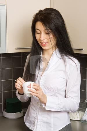 Coffee break stock photo, Pretty brunette girl at coffee break in the office by Mikhail Lavrenov