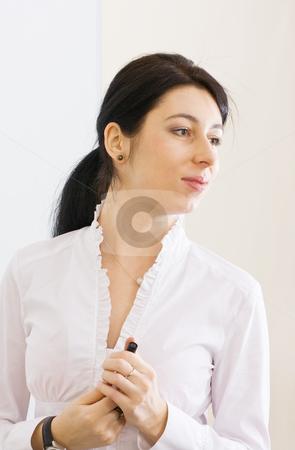 Pretty brunette girl making presentation stock photo, Pretty brunette girl making presentation in the office by Mikhail Lavrenov
