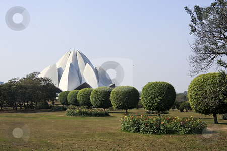 Lotus Temple in Delhi India stock photo, This temple beloning to the Baha'i sect has become an important landmark of Delhi. Many term it as the Taj of modern India. This structure is made of pure white marble in the shape of a half opened lotus. It is surrounded by beatifully manicured lawns. by Sharron Schiefelbein