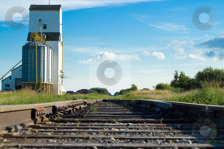 Railway  stock photo, A railway going to a prairie grain elevator shot on a partly cloudy day by Richard Nelson