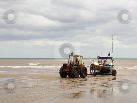 Towing the boat stock photo, A tractor towing a fishing boat to shore in summer by Mike Smith