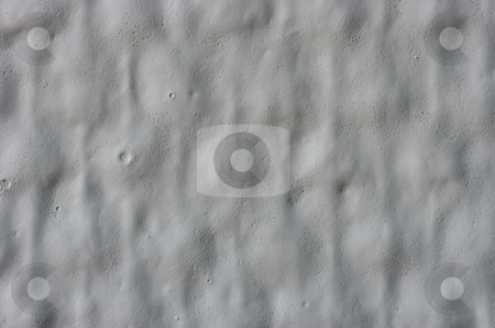 Moon Wall stock photo, An extreme closeup of a painted wall, looking like the landscape on the moon. by Peter Soderstrom