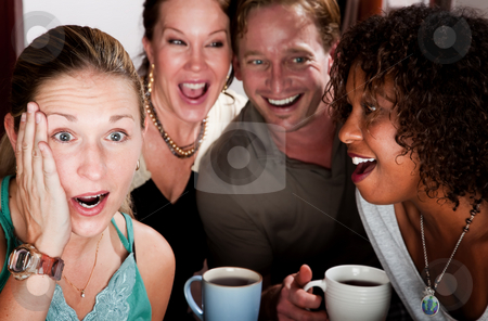 Four Friends Gossiping in a Coffee House stock photo, Four adult gossiping friends meeting in a coffee house by Scott Griessel
