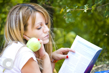 Beautiful young woman outdoor stock photo, Beautiful young woman working out with laptop and reading books by Desislava Dimitrova