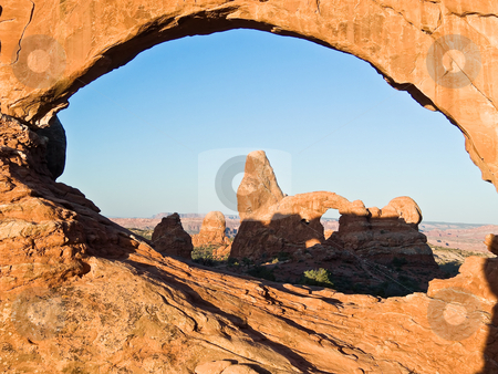 Turret Arch through North Window stock photo, The Turret Arch viewed through the North Window Arch very early in the morning at Arches National Park just outside Moab, Utah by Kenneth Keifer