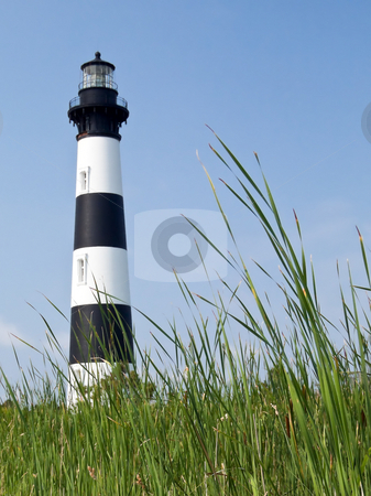 Bodie Island Lighthouse, Outer Banks, North Carolina stock photo, Bodie Island Light, here viewed from the surrounding reed grass, stands sentinel over its stretch of North Carolina's Outer Banks, Cape Hatteras National Seashore. by Kenneth Keifer