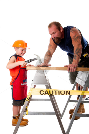 Father and son carpenter job stock photo, Father is teaching son how to use a hammer, trying to hit a nail into a wood board, isolated. by Paul Hakimata