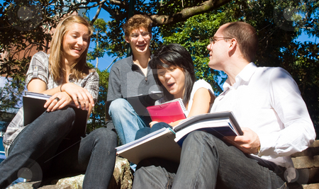 Happy Students stock photo, Four college students having fun on the steps of the college grounds by Corepics VOF